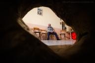 Dal pavimento della piccola chiesa di San Vito, nelle campagne di Calimera, fuoriesce una pietra forata. Come conferma Silvano Palamà (ritratto nella foto), studioso e curatore della Casa-museo della Civiltà Contadina e della Cultura Grica, l'attuale tradizione di passarvi attraverso durante il Lunedì di Pasquetta, deriva da quei rituali di propiziazione, purificazione o iniziazione ampiamente diffusi in tutta Europa nel periodo precristiano e spesso riadattati per la nuova religione monoteista. (La Pietra, il Bosco, la Chiesa. San Vito, o della pietra forata, Silvano Palamà, Quaderni della Casa-Museo, n°1, Luglio 2106).